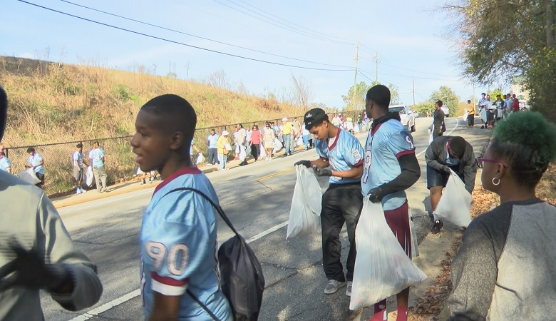 Carver High students honor the King holiday by cleaning up a street named in his honor.