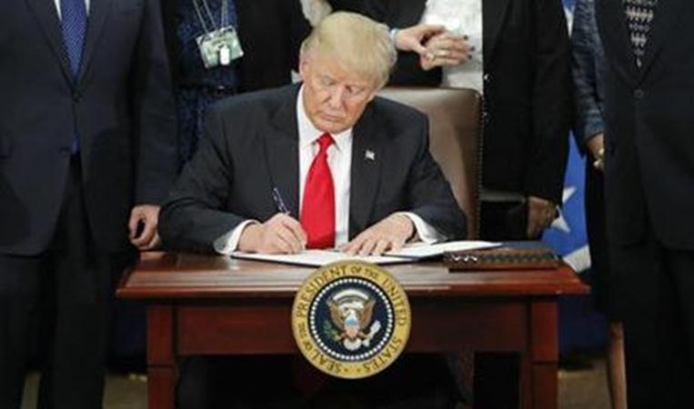 trump_sign_action-copy_175212
