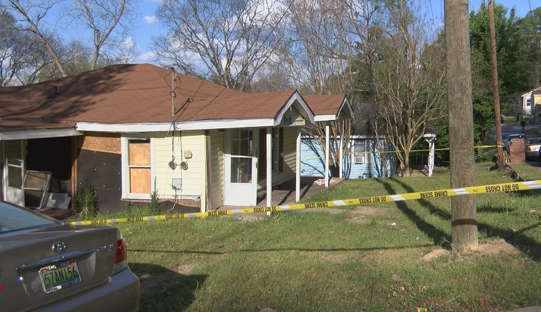Phenix City Police discovered a dead homeless man Sunday inside this abandoned home on 11th St.