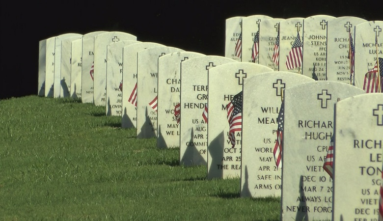 Volunteers planted flags at each grave inside Ft. Mitchell National Cemetery Saturday.