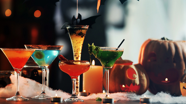 Colorful cocktails and decor for Halloween party, on blurred bac_297583