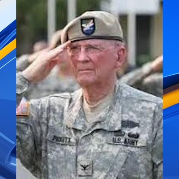 Ret. Col. Ralph Puckett salutes in uniform