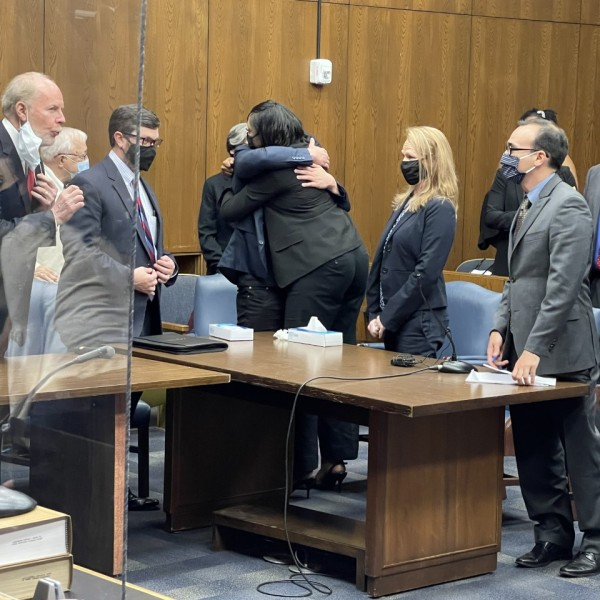 debelbots hug after charges dropped